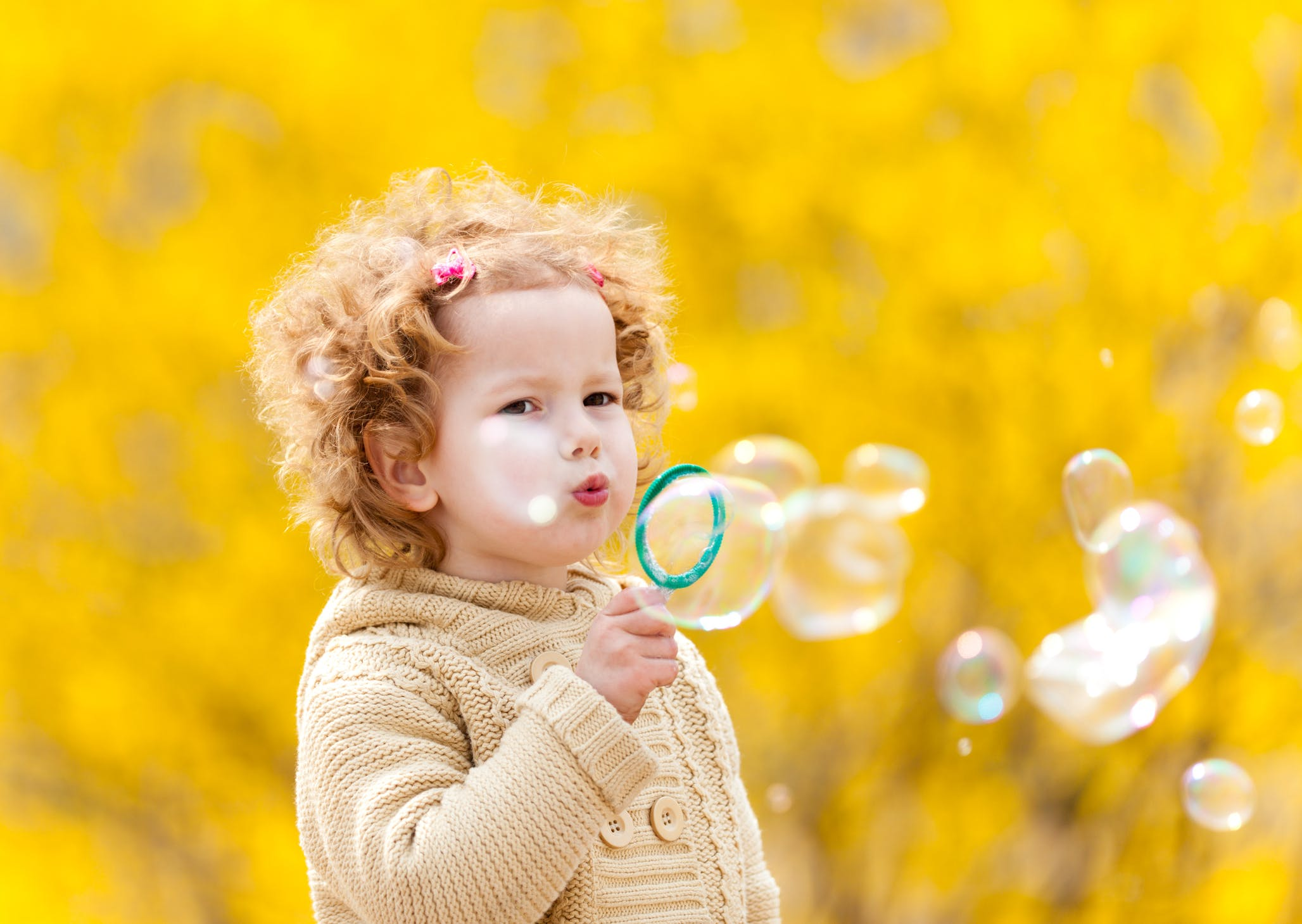 Redhead cute girl blowing bubbles.jpg?ixlib=rails 3.0
