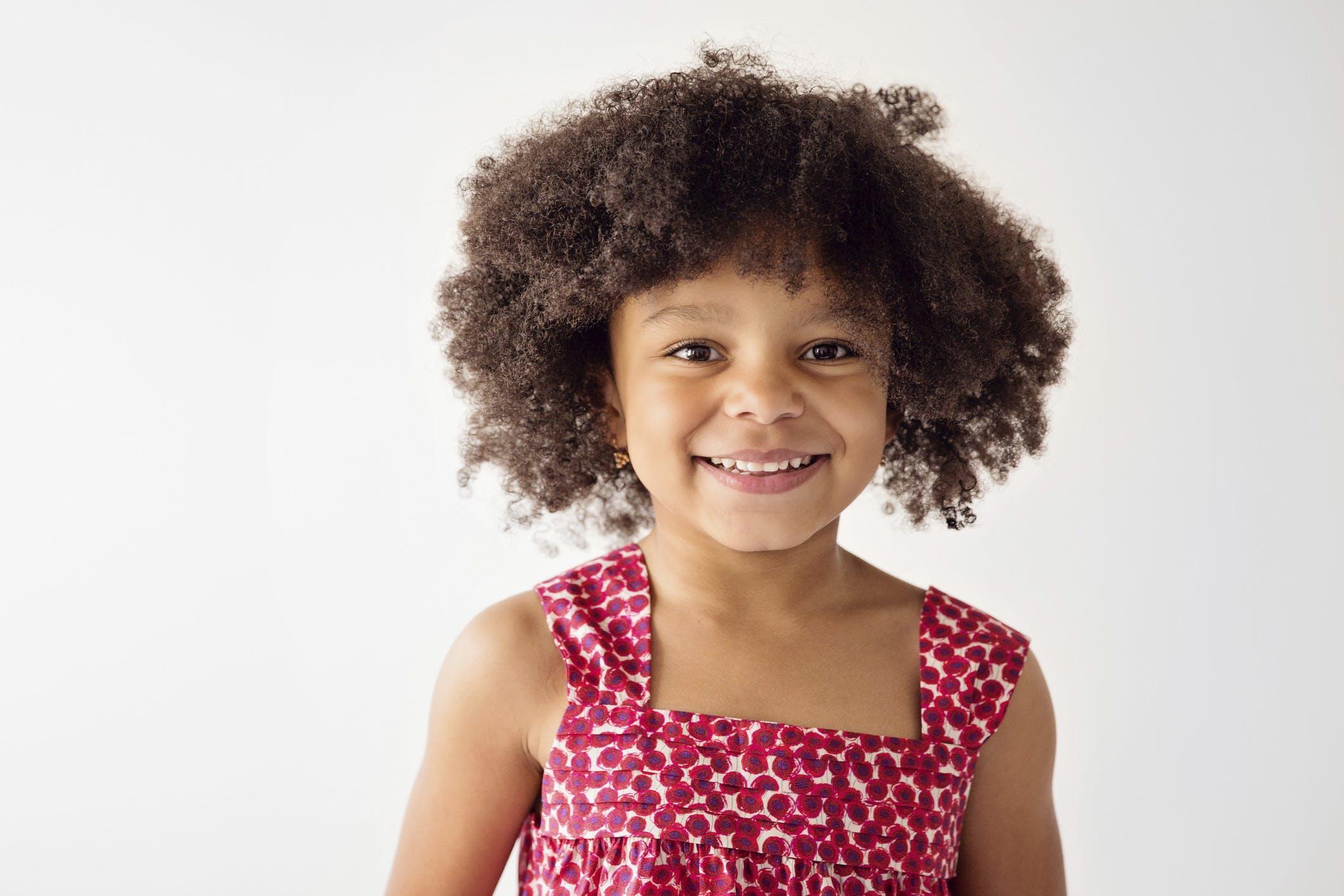 Cute black girl wearing dress white background.jpg?ixlib=rails 3.0