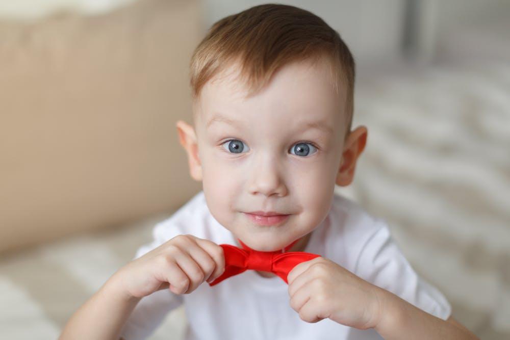 Boy bowtie nerdy happy.jpg?ixlib=rails 3.0