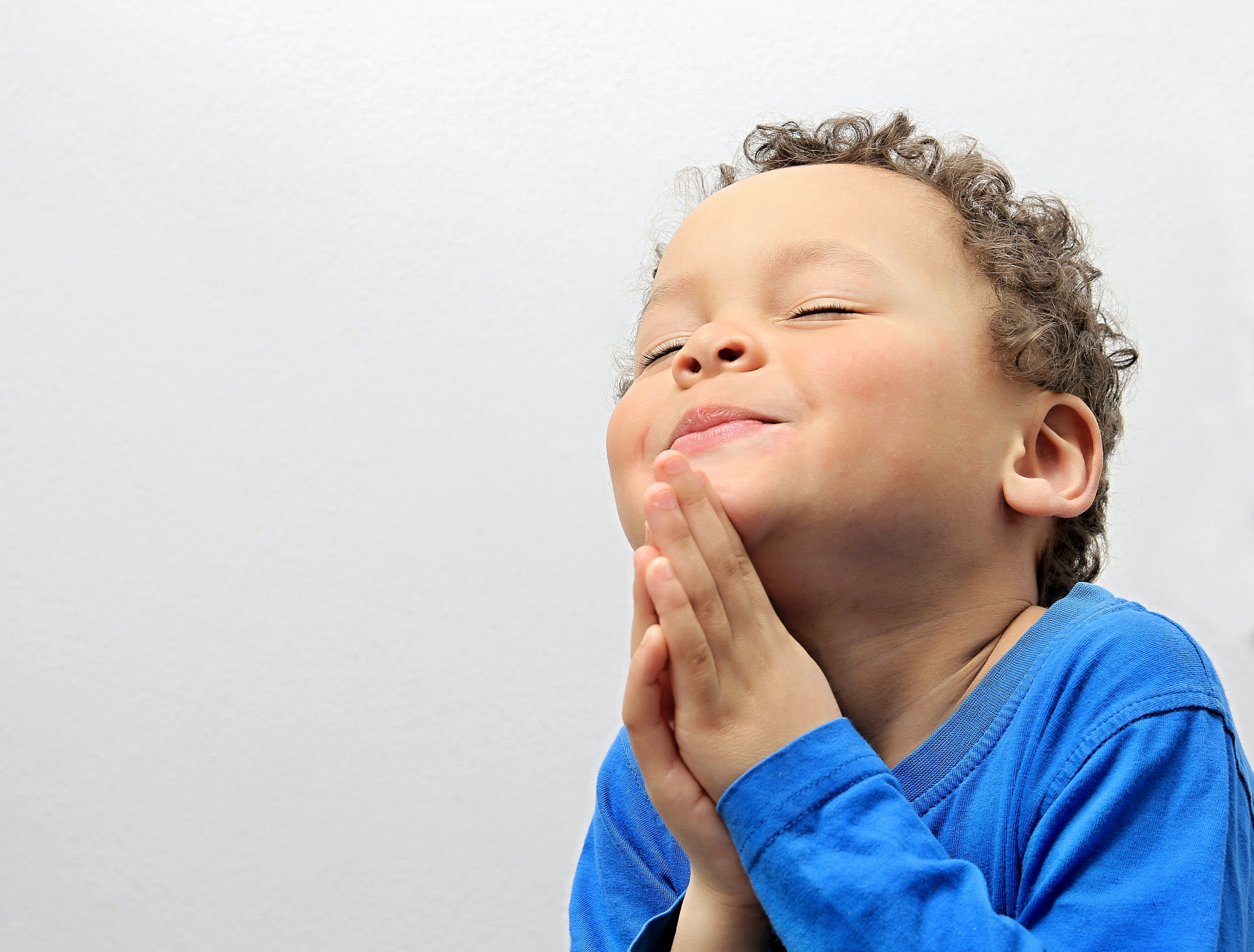 Boy praying.jpg?ixlib=rails 3.0