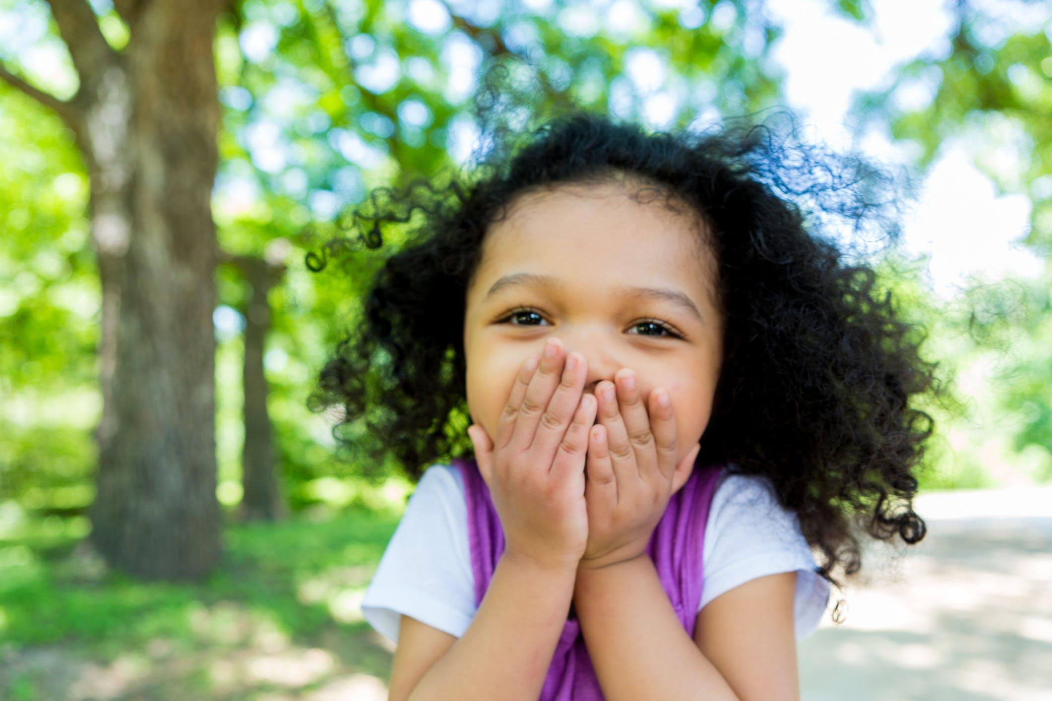 Funny girl black holding back laugh.jpg?ixlib=rails 3.0