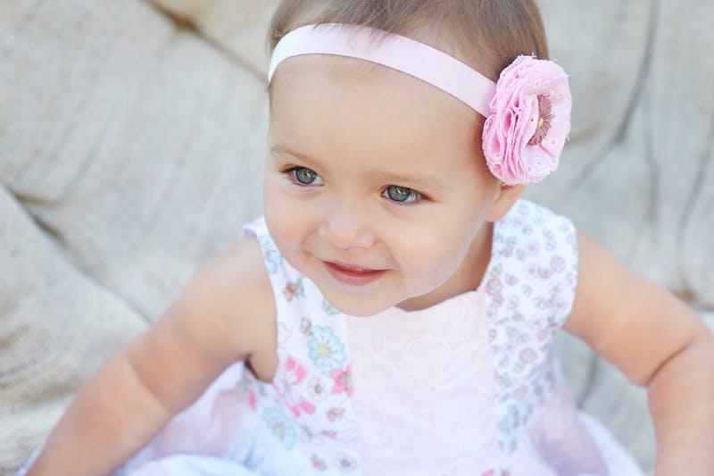 Dressed up baby girl pink.jpg?ixlib=rails 3.0